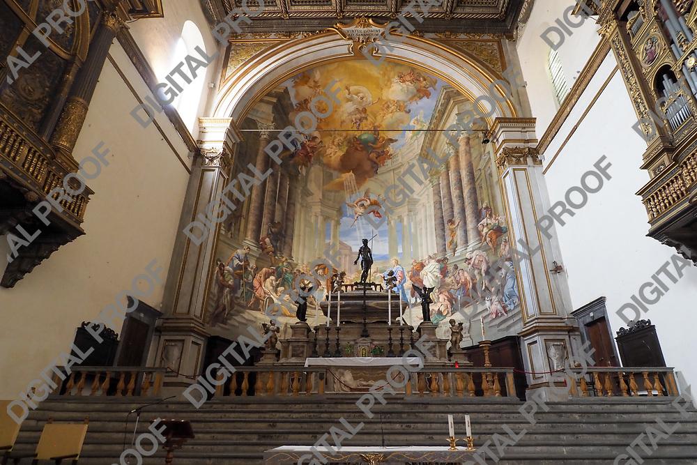 Main altar of Santa Maria della Scala Church in Siena Italy during the day