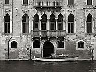The facade on the Rio della Misericordia of Ca' Pesa Papafava, a XIV century palace in the Sestiere of Cannaregio in Venice, Italy