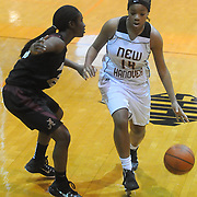 New Hanover's Tanasia Toomer drives around Ashley's Jada Bacchus Friday December 19, 2014 at New Hanover High School in Wilmington, N.C. (Jason A. Frizzelle)