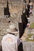 Archaeologist surveying stairs at machu Picchu. Peru, South America