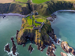 Aerial view from drone of Dunnottar Castle on cliffs above North Sea at Stonehaven  in Aberdeenshire, Scotland, UK
