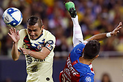 Chivas de Guadalajara's Jesus Molina, right, kicks the ball past Club America's Paul Aguilar during the second half of the Super Clasico soccer match Sunday, Sept. 8, 2019, in Chicago.   (AP Photo/Jim Young)