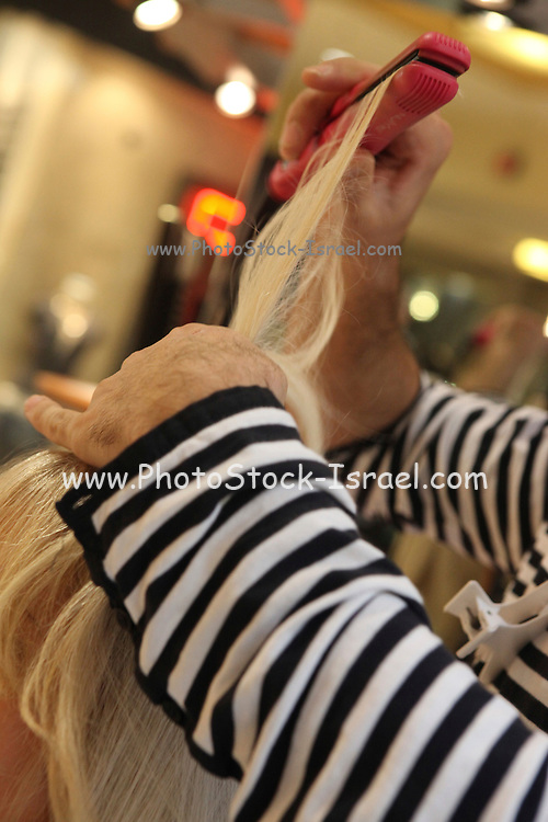 woman having her hair cut by male hair dresser