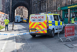 Edinburgh's Cowgate has been closed following reports of an individual falling from the George IV bridge. Police and ambulance are in attendance.