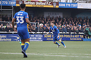 AFC Wimbledon midfielder Jake Reeves (8) aims a shot at goal during prior The FA Cup match between Sutton United and AFC Wimbledon at Gander Green Lane, Sutton, United Kingdom on 7 January 2017. Photo by Stuart Butcher.