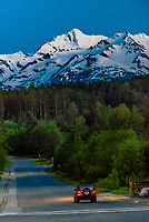 Late evening twilight in Haines, Alaska USA. Haines is surrounded by mountains and water. Rising high above the town are the Takinsha Mountains and Chilkat Range to the south, Takshanuk Mountains to the north and Coast Mountains to the east across the Lynn Canal.