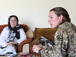 "© Licensed to London News Pictures. 15/06/2012. Helmand. "" When I meet soldiers like Jess I hope that women from Afghanistan will see her and also want to put on a uniform, get a job and learn to be independent'"" Comments Gullali (L), Head of the Department of Womens Affairs. (DoWA) in Gereshk, Helmand Province. Army women 'engagement officers' working in Afghanistan. Trained in Pashto, the Afghan language, they accompany infantry on patrols and build relationships with Afghan women in some of the most dangerous parts of Helmand. Photo credit : Alison Baskerville/LNP"