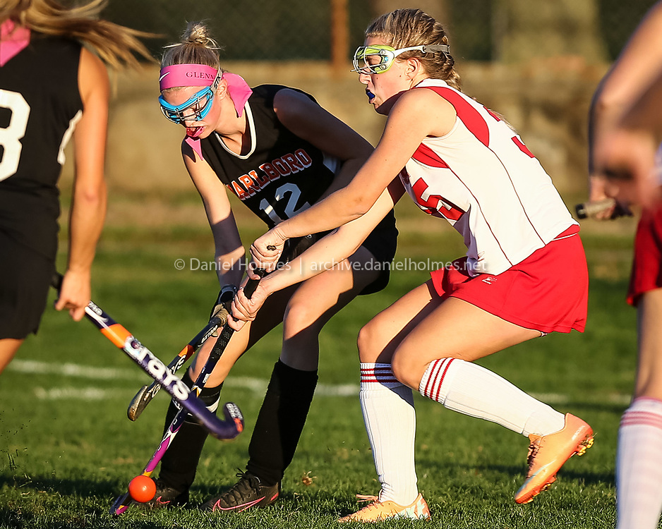 (10/12/16, HUDSON, MA) Marlborough's Catherin Glennon, left, and Hudson's Jackie Rossley fight for the ball during the girls field hockey at Hudson High School in Hudson on Wednesday. Daily News and Wicked Local Photo/Dan Holmes