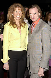 The HON.AURELIA CECIL and MR HAMISH BOWLES at a party hosted by Donatella Versace to launch the new Versace Woman fragrance at Attica, 24 Kingly Street, London W1 on 19th February 2001.<br /> <br /> Photo by Dominic O'Neill/Desmond O'Neill Features Ltd.  +44(0)1306 731608  www.donfeatures.com