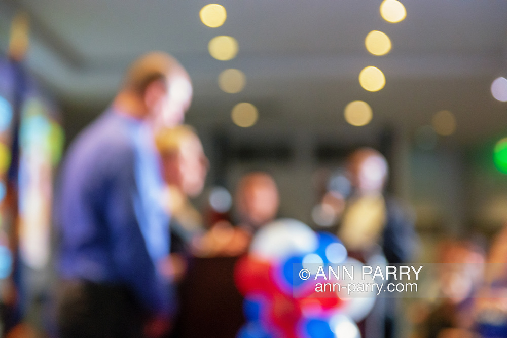 Garden City, New York, USA. November 6, 2018. Nassau County Democrats watch Election Day results at Garden City Hotel, Long Island. LIUBA GRECHEN SHIRLEY, candidate for New York Congressional District 2, speaks to supporters after incumbent King is declared winner. CHRISTOPHER SHIRLEY, her husband, joined her onstage.