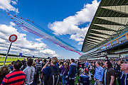 The Red Arrows do a fly past - Red Bull Air Race World Championships at Ascot Race Course. A combination of high speed, low altitude and extreme manoeuvrability make it only accessible to the 'world's most exceptional pilots'. 12 pilots compete in the Master Class category in eight races across the globe for the title of 2014 Red Bull Air Race World Champion. The objective is to navigate an aerial racetrack featuring air-filled pylons in the fastest possible time, incurring as few penalties as possible. All 12 pilots race with a standardised propulsion package – a high-performance, race-tuned standardised engine (Lycoming Thunderbolt) and standardised propellers (Hartzell 3-bladed). They do have a chooice of 3 single engine/seater aircraft - the Zivko Aeronautic Edge 540, the MXS-R and the Hungarian University of Aviation's Corvus Racer 540 - all cappable of around 230kts and of surviving high G forces, 10+. A new feature of the 2014 Red Bull Air Race World Championship is the debut of the new Challenger Cup, giving a new generation of talented pilots from around the world a chance to race. Entertainement is provided by the Red Arrows and the Breitling Wingwalkers, amongst others.  Ascot Racecourse, High St, Ascot, Berkshire, UK.