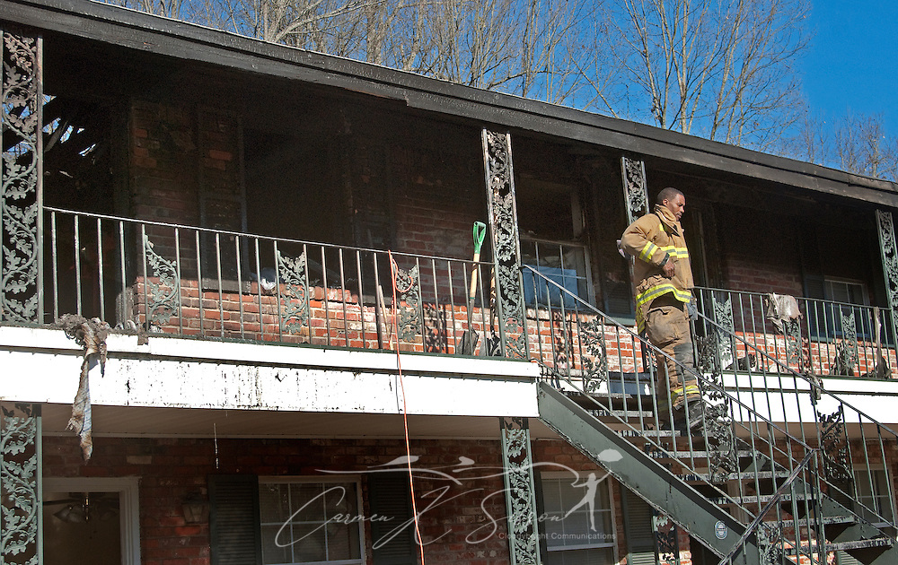 Charles Yarbrough, of the Starkville Fire Department, walks down the staircase of an apartment building at Academy Crossing in Starkville, Miss., where an early morning fire took the lives of nine people, including six children, Dec. 28, 2009. Oktibbeha County coroner Mike Hunt said the children ranged in age from four months to six years old. The cause of the fire is still under investigation. (Photo by Carmen K. Sisson/Cloudybright)