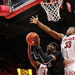 Anthony Lee #3 of the Temple Owls recovers a rebound away from Wally Judge #33 of the Rutgers Scarlet Knights during the second half of Rutgers men's basketball vs Temple Owls in American Athletic Conference play on Jan. 1, 2014 at Rutgers Louis Brown Athletic Center in Piscataway, New Jersey.