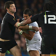Stephen Donald New Zealand, (left) makes a tackle in his two sizes too small shirt during the New Zealand V France Final at the IRB Rugby World Cup tournament, Eden Park, Auckland, New Zealand. 23rd October 2011. Photo Tim Clayton...