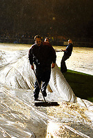 Photo: Alan Crowhurst/Sportsbeat Images.<br />Horsham v Swansea City. The FA Cup. 30/11/2007. A groundsman sweeps water off the pitch.