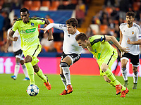 Valencia's Santi Mina and KAA Gent's Renato Neto (l), Marko Poletanovic  during Champions league match. October 20, 2015. (ALTERPHOTOS/Javier Comos)