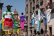 Paper doll effigies hang in the Plaza Allende in preparation for the Burning of Judas Easter-time ritual marking the end of Holy Week April 1, 2018 in San Miguel de Allende, Mexico. The effigies are filled with fireworks and explode to the entertainment of the crowd in a good natured symbolic renewal and clearing out demons.