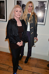 Left to right, DEBBIE HARRY and LAURA BAILEY at a private view of Chris Stein/Negative: Me, Blondie And The Advent Of Punk, held at Somerset House, The Strand, London on 5th November 2014.