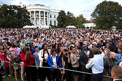 President Barack Obama greets guests during an event for political appointees on the South Lawn of the White House, Sept. 15, 2014. (Official White House Photo by Pete Souza)<br /> <br /> This official White House photograph is being made available only for publication by news organizations and/or for personal use printing by the subject(s) of the photograph. The photograph may not be manipulated in any way and may not be used in commercial or political materials, advertisements, emails, products, promotions that in any way suggests approval or endorsement of the President, the First Family, or the White House.