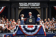 President Bill Clinton is introduced by school children during a campaign stop for his re-election August 27, 1996 in Wayandotte, MI