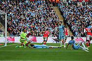 Manchester city players slump dejected as Alexis Sanchez of Arsenal © runs and celebrates  after he scores his teams 2nd goal in the 1st period of extra time. The Emirates FA Cup semi-final match, Arsenal v Manchester city at Wembley Stadium in London on Sunday 23rd April 2017.<br /> pic by Andrew Orchard,  Andrew Orchard sports photography.
