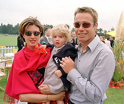 MR & MRS GRAEME LE SAUX he is the England international footballer and their daughter GEORGINA, at a polo match in Sussex on 23rd July 2000.OGI 121
