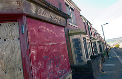 Boarded up terraced housing & closed corner shop in Newcastle's West End, Houses due to be demolished for redevelopment UK 2004