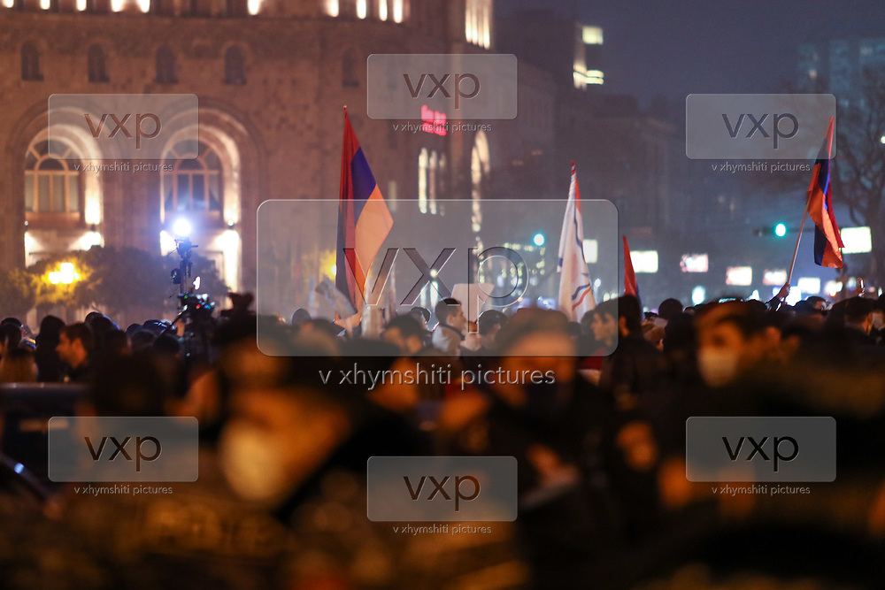 People attend a rally demanding the resignation of Armenia's Prime Minister Nikol Pashinyan outside Prime Minister's office in Yerevan, Armenia on Tuesday, Dec 15, 2020. Capital Yerevan has seen on-going protests since the November 9 ceasefire that was signed in Nagorno-Karabakh between Armenia, Russia, and Azerbaijan, an agreement that came into effect and resulted with Armenian troops withdrawal from the troubled region. (VXP Photo/ Vudi Xhymshiti)