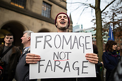 © Licensed to London News Pictures. 26/01/2019. Manchester, UK. A man holds up a FROMAGE NOT FARAGE placard in St Peter's Square . A cross party demonstration by hundreds of supporters of a People's Vote on Britain's membership of the EU is held in St Peters Square , followed by a march to the Mechanics Institute and rally of supporters . Photo credit: Joel Goodman/LNP