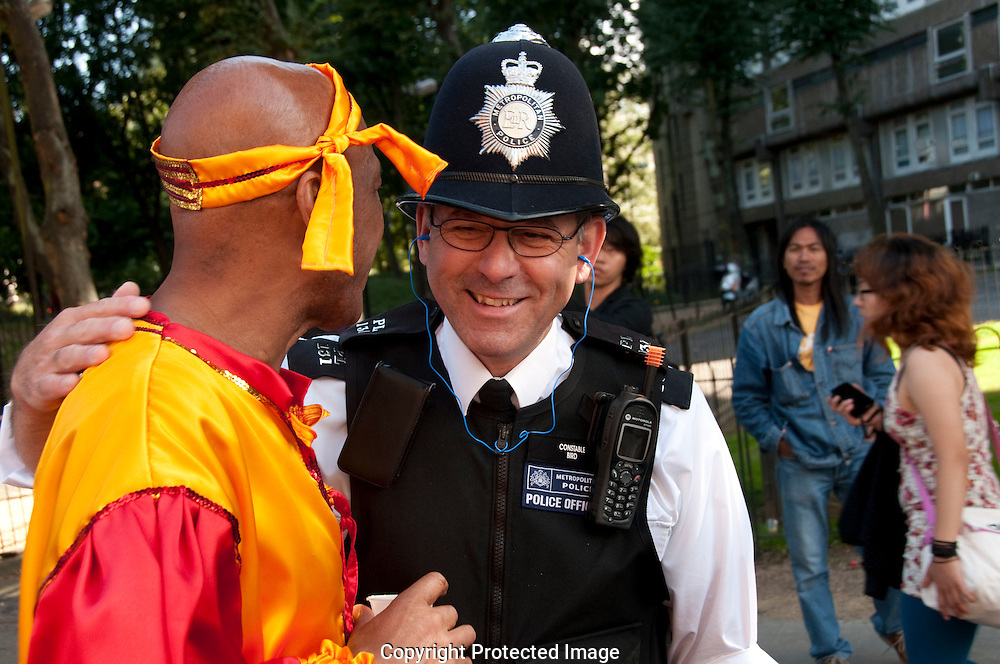 Notting Hill Carnival participant chatting and laughing with friendly police officer