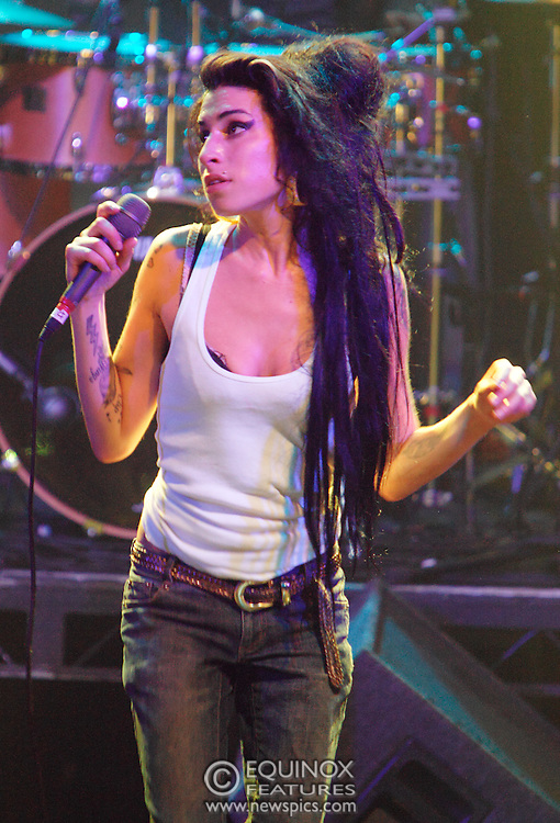 Singer Amy Winehouse, DOB=14/09/1983, performing for her gay fans at the G-A-Y Club. G-A-Y is London's biggest gay club and is held at the London Astoria nightclub, Soho, London, UK. Amy spent much of the show rubbing her itchy nose. She also seemed to have signs of old scars all down one arm...Picture Data:.Photographer: Edward Hirst.Copyright: ©2007 Licensed to Equinox News Pictures +448700 780000.Contact: Equinox Features.Date Taken: 20070415.Time Taken: 020502+0000.www.newspics.com