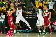 WACO, TX - JANUARY 24: Taurean Prince #21 of the Baylor Bears defends against the Oklahoma Sooners on January 24, 2015 at the Ferrell Center in Waco, Texas.  (Photo by Cooper Neill/Getty Images) *** Local Caption *** Taurean Prince