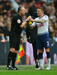 Kieran Trippier of Tottenham Hotspur gives the linesman a helping hand to take a drink during a break in play. - Mandatory by-line: Alex James/JMP - 06/10/2018 - FOOTBALL - Wembley Stadium - London, England - Tottenham Hotspur v Cardiff City - Premier League