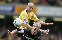 Photo: Lee Earle.<br /> Watford v Hull. Coca Cola Championship. 30/04/2006. Watford's Gavin Mahon (L) clashes with Stuart Green.