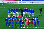 Leeds United players huddle for a minute silence during the Premier League match between Crystal Palace and Leeds United at Selhurst Park, London, England on 7 November 2020.