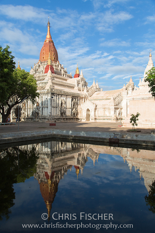 View of Ananda temple in Bagan, with reflection in pool.