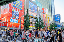Busy street in Akihabara known as Electric Town or Geek Town selling Manga based games and videos in Tokyo Japan