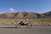 Jan Bos van het Human Power Team Delft en Amsterdam rijdt op zijn trainingsfiets. In de buurt van Battle Mountain, Nevada, strijden van 10 tot en met 15 september 2012 verschillende teams om het wereldrecord fietsen tijdens de World Human Powered Speed Challenge. Het huidige record is 133 km/h.<br /> <br /> Jan Bos of the Dutch Human Power Team Delft and Amsterdam is riding his training bike. Near Battle Mountain, Nevada, several teams are trying to set a new world record cycling at the World Human Powered Vehicle Speed Challenge from Sept. 10th till Sept. 15th. The current record is 133 km/h.