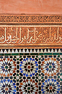 Berber arabesque  plasterwork and Zellige tiles of the 14th century Ben Youssef Madersa (Islamic college) re-constructed by the Saadian Sultan Abdallah al-Ghalib in 1564 as the largest and most prestigious Medersa in Morocco. Marrakesh, Morroco .<br /> <br /> Visit our MOROCCO HISTORIC PLAXES PHOTO COLLECTIONS for more   photos  to download or buy as prints https://funkystock.photoshelter.com/gallery-collection/Morocco-Pictures-Photos-and-Images/C0000ds6t1_cvhPo<br /> .<br /> <br /> Visit our ISLAMIC HISTORICAL PLACES PHOTO COLLECTIONS for more photos to download or buy as wall art prints https://funkystock.photoshelter.com/gallery-collection/Islam-Islamic-Historic-Places-Architecture-Pictures-Images-of/C0000n7SGOHt9XWI
