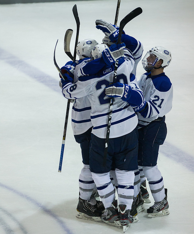 Brendan Cosgrove, Scott Harff, and Ben Chwick of Colby College celebrate Cosgrove's goal in an NCAA Division III college hockey game against Williams College at Alfond Rink at Alfond Arena, Saturday Nov. 17, 2012 in Waterville, ME. (Dustin Satloff/Colby College Athletics)