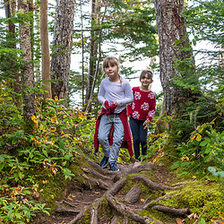 Two girls on a trail at Quoddy Head State Park in Lubec, Maine.