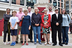 © Licensed to London News Pictures. 04/09/2017. London, UK.  Blood cancer sufferers and survivors stand amongst 104 three dimensional names installed in Paternoster Square near St. Paul's cathedral to mark the launch of the 'Make Blood Cancer Visible' campaign.  Designed by Paul Cocksedge, the typographic forest of names represents the 104 individuals diagnosed with blood cancer daily.  Each piece symbolises an individual with blood cancer, the height corresponds to the height of that individual and bears a write-up of their particular type of blood cancer.  Photo credit : Stephen Chung/LNP