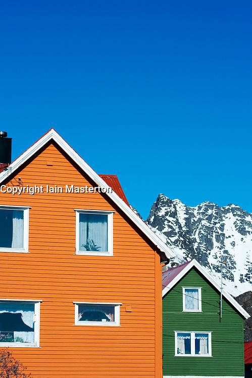Brightly painted wooden houses in village of Henningsvaer in Lofoten Islands in Norway