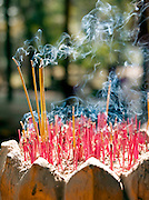 Incense sticks given as offerings burn at a temple of Angkor, Siem Reap Province, Cambodia