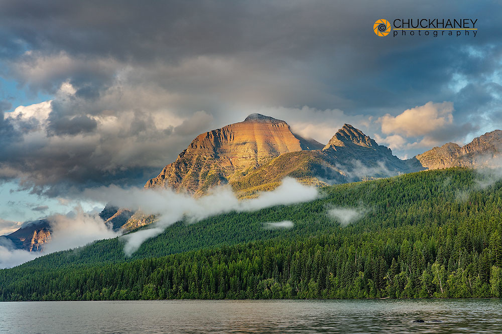 Stormy late afternoon light on Rainbow Peak at Bowman Lake in Glacier National Park, Montana, USA