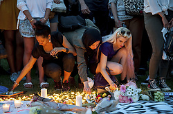 June 19, 2017 - Members of the public hold a vigil outside the Houses of Parliament in London for those who lost their lives in the Grenfell Tower Block fire in Notting hill last week. (Credit Image: © Guilhem Baker/London News Pictures via ZUMA Wire)