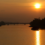 The golden sunset over the Perfume River in Hue in central Vietnam.