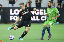 April 29, 2018 - Los Angeles, CA, U.S. - LOS ANGELES, CA - APRIL 29: Los Angeles FC defender Walker Zimmerman (25) launches the ball downfield asSeattle Sounders midfielder Clint Dempsey (2) pressures him in the game between the Saettle Sounders FC and Los Angeles FC on April 29, 2018 at Banc of California Stadium in Los Angeles, CA. (Photo by Peter Joneleit/Icon Sportswire) (Credit Image: © Peter Joneleit/Icon SMI via ZUMA Press)