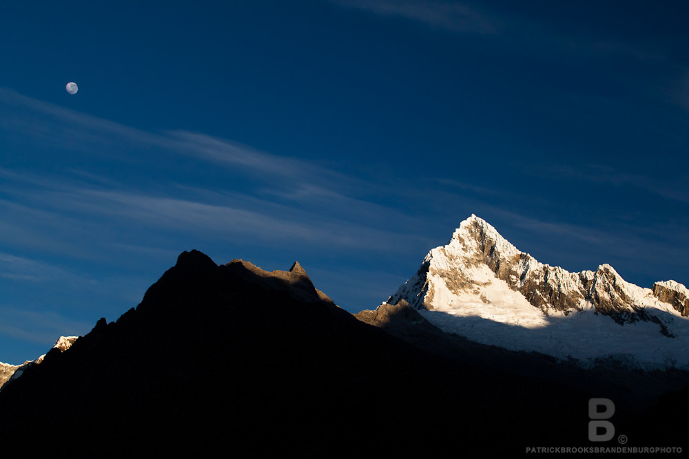 Dramatic peaks in the sunrise as the moon starts to fall in the Codillera Blanca of the Andes Mountains in Peru. 8.16.11