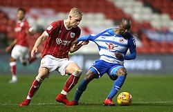 Bristol City's Hordur Bjorgvin Magnusson (left) and Reading's Sone Aluko battle for the ball